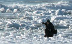Scott photographing surfing in Alaska