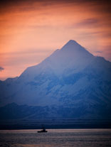 photo with view of sunset and Mt. St. Elias in Yakutat, Alaska.