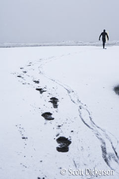 Snowy winter surf session in Alaska.