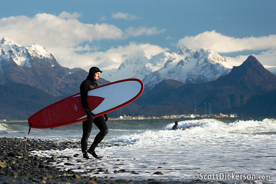 Brad Conley heads out for a fall surf in Homer, Alaska.