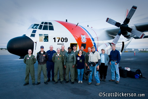 Group photo of the people involved in a cooperative effort to search for swimming polar bears in the Chukchi Sea, Arctic Alaska. The Coast Guard Air Station Kodiak C-130 carried the searchers on the mission.