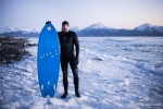 surfer on ice in Alaska