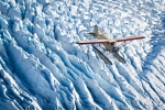 Air-Air Stinson over glacier, Alaska, Scott Dickerson Photography