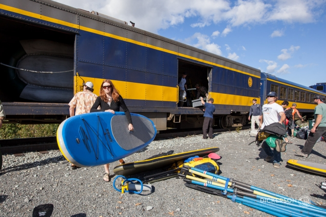 unloading inflatable stand up paddleboards from the Alaskan Railroad