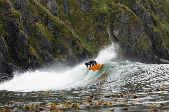 Dan Malloy surfing in Alaska from the m/v Milo
